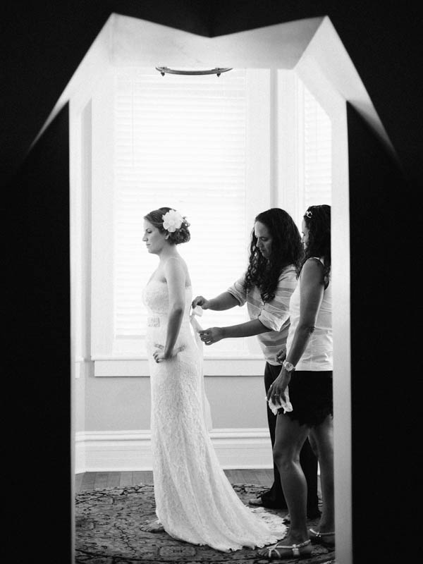bride getting in her gown