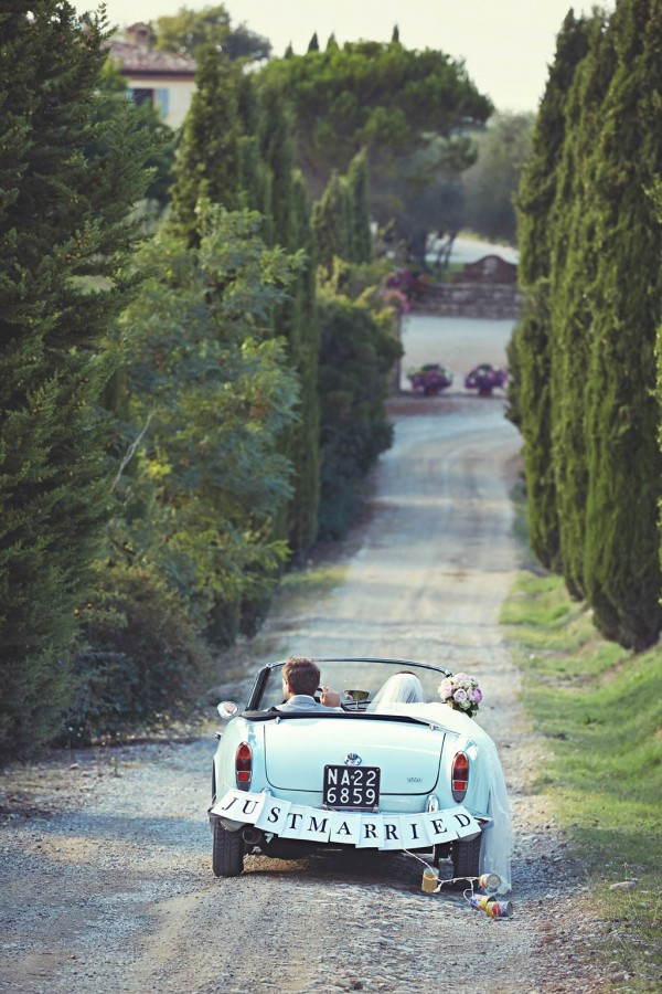 adorable just married car in Italy