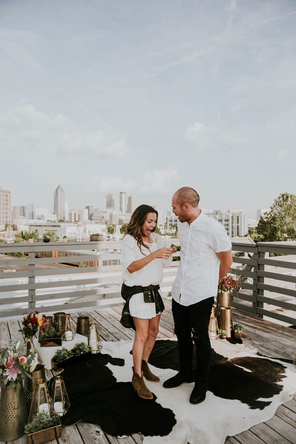 modern-rooftop-proposal-overlooking-the-atlanta-skyline-26