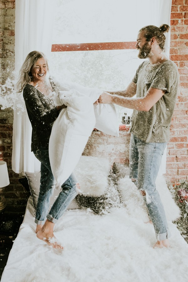 This Couple's Pillow Fight Photo Shoot is Fun, Flirty, and Full of Feathers