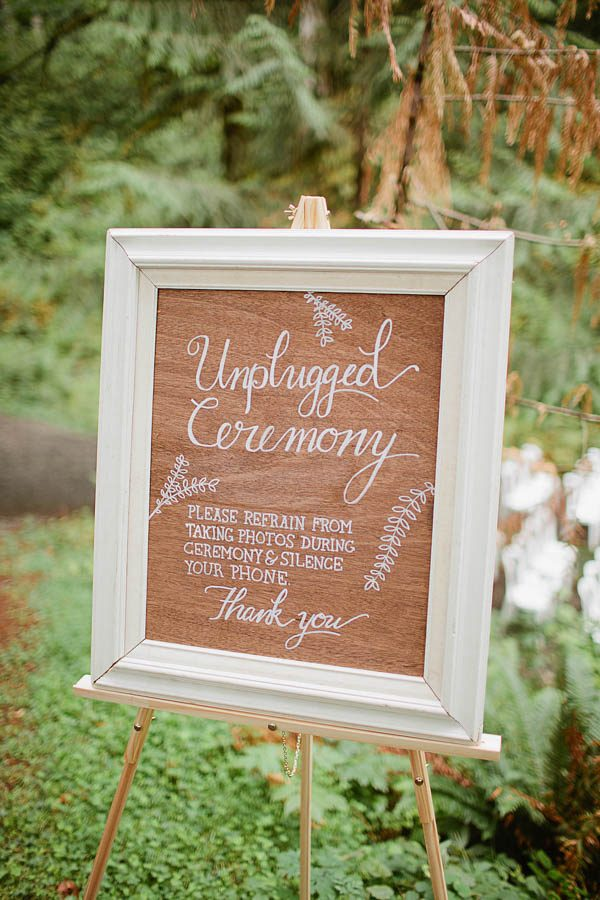 handwritten unplugged ceremony sign on wood