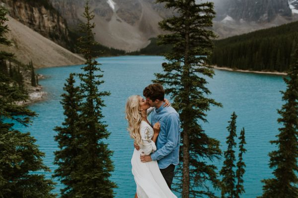 a-sudden-storm-only-made-this-lake-louise-engagement-more-stunning-nathan-walker-photography