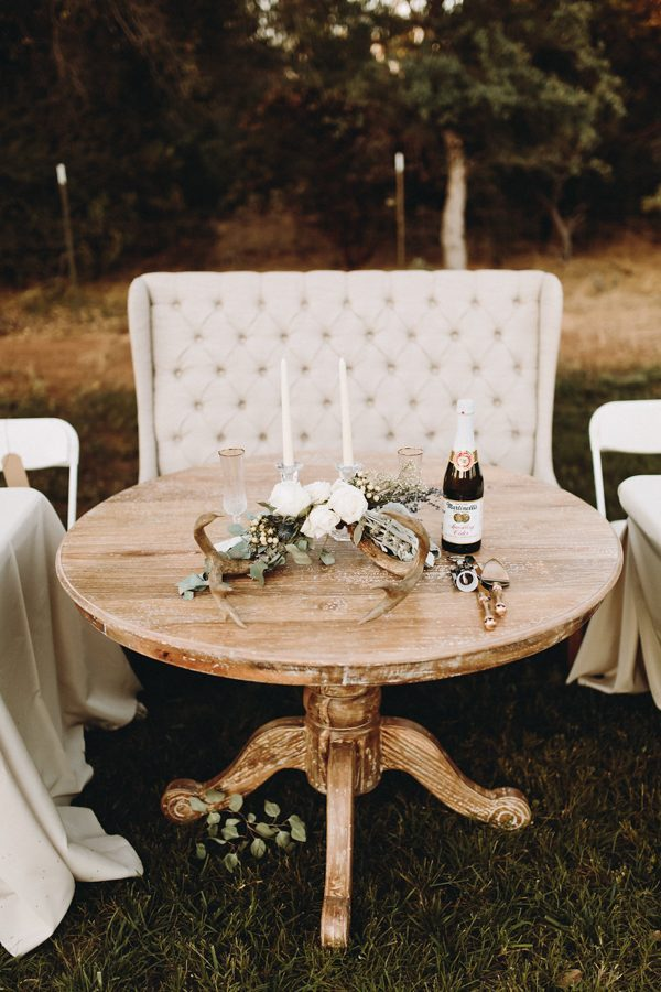 rustic glam sweetheart table with round table and loveseat