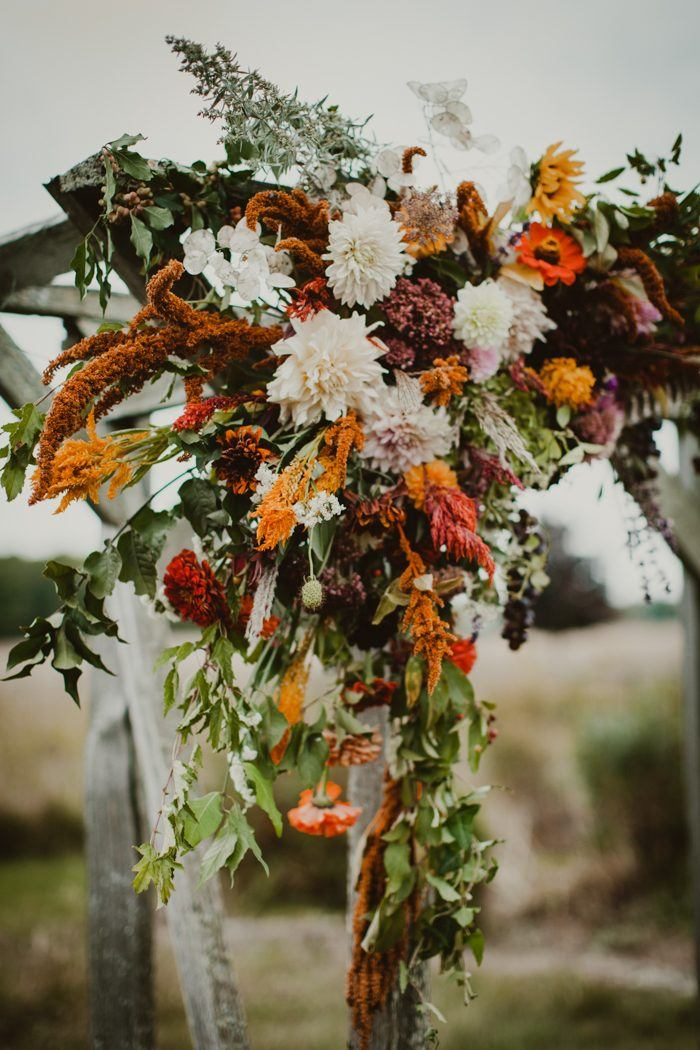 every stem was cut or foraged from their small sustainable flower farm from the weathered branch table runner to the rustic grapes and