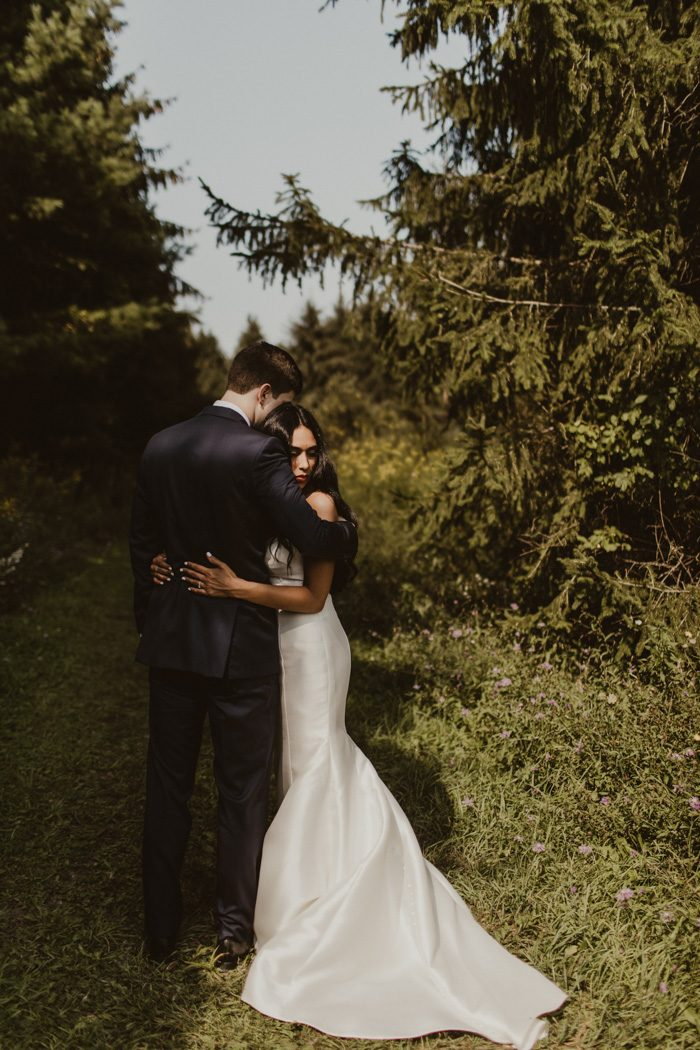 Diy went a long way in this gorgeous green lakes state park wedding picture this a rustic wooden cabin a garden of eucalyptus and a crystal clear lake in the background of an intimate ceremony thats what robert michael junglespirit