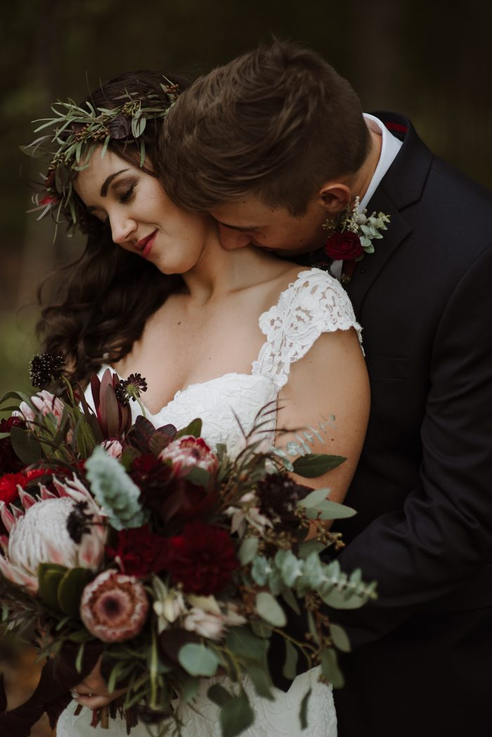 Get inspired by this gorgeous outdoorsy indoor wedding at coppes meagan and logans wedding at coppes commons in indiana is for you using a mix of moody florals from fifty flowers and lb floristry vintage table decor junglespirit Image collections