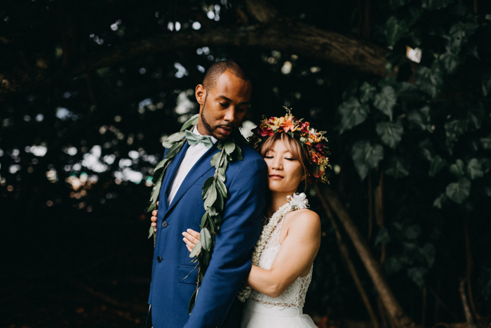 b867185312 Midori and Chris' intimate beach wedding at Kualoa Ranch was as vibrant and  joyful as it was heartfelt and emotional. Before their beach ceremony, ...