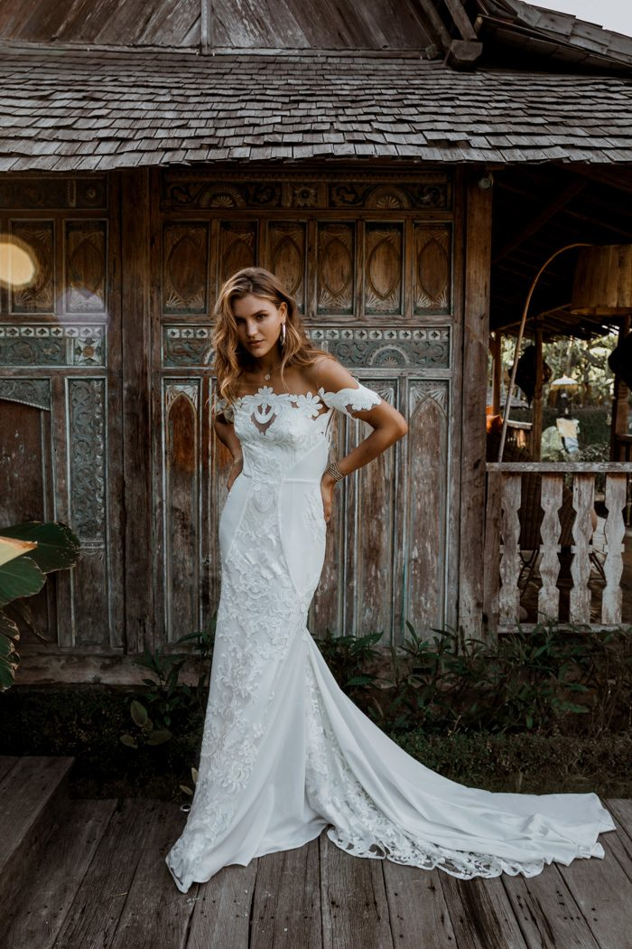 a8aea7ca0f6 With its bold floral embroidered lace and chic crepe