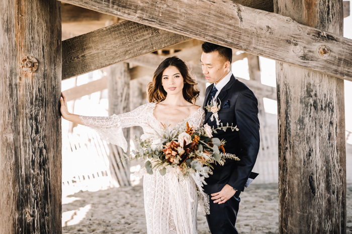 e7eb5c818e Two gorgeous Watters wedding gowns? Check and check! This Seal Beach Pier  wedding has all the dreamy boho wedding ...