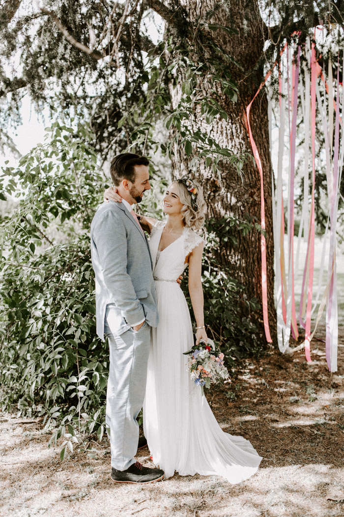 1ba36be684 We wanted to include as many colors as we could in our wedding with the  flowers, lanterns, table settings and the ribbons we hung from a tree which  became ...