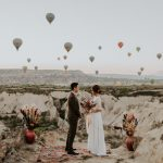 Unique Elopement Alert: This Couple Exchanged Vows Among Over 100 Hot Air Balloons in Cappadocia, Turkey