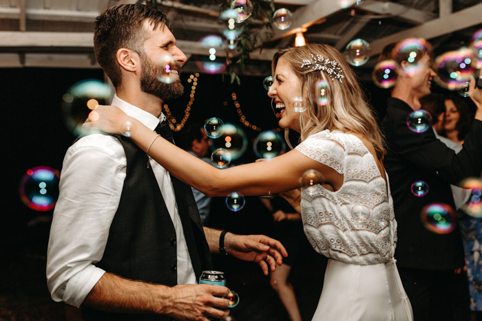 This Wedding Reception Playlist Is Guaranteed To Get Your Guests