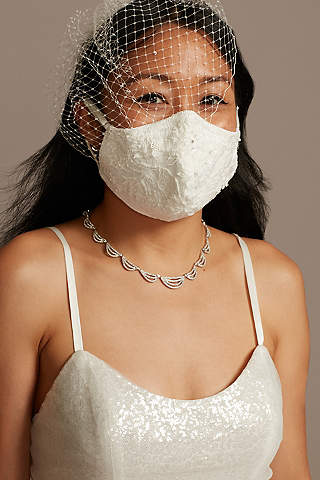 bride with veil and white lace face mask