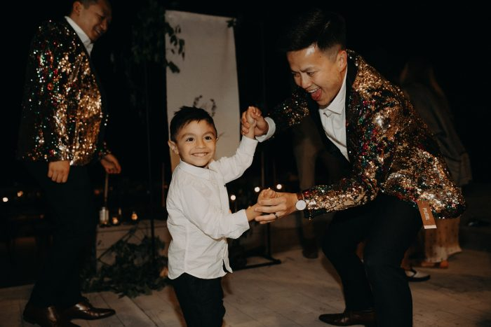groom dancing with child