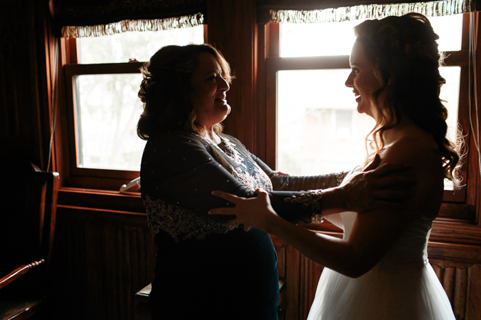 mother of bride and bride embracing