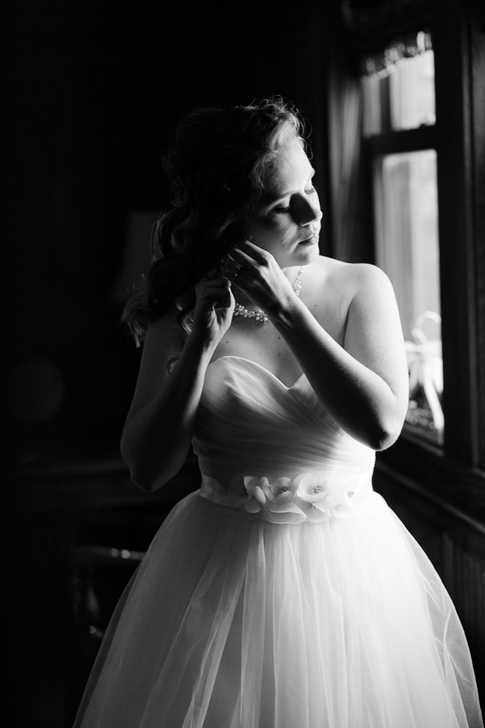 bride adjusting her jewelry for Moore's cove falls wedding