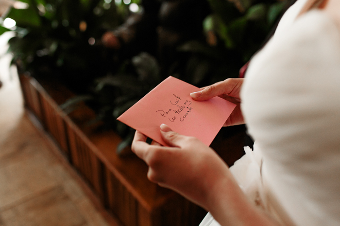 bride holding letter from loved ones
