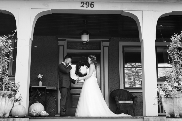 groom kissing bride after first look
