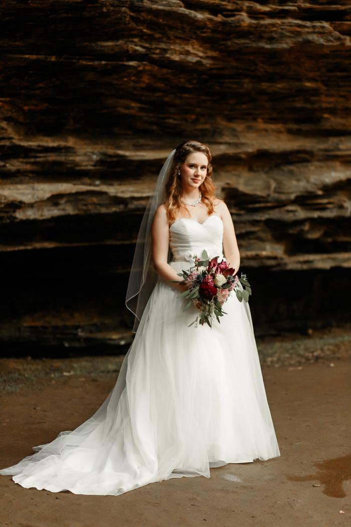 bride posing in Moore's cove falls wedding