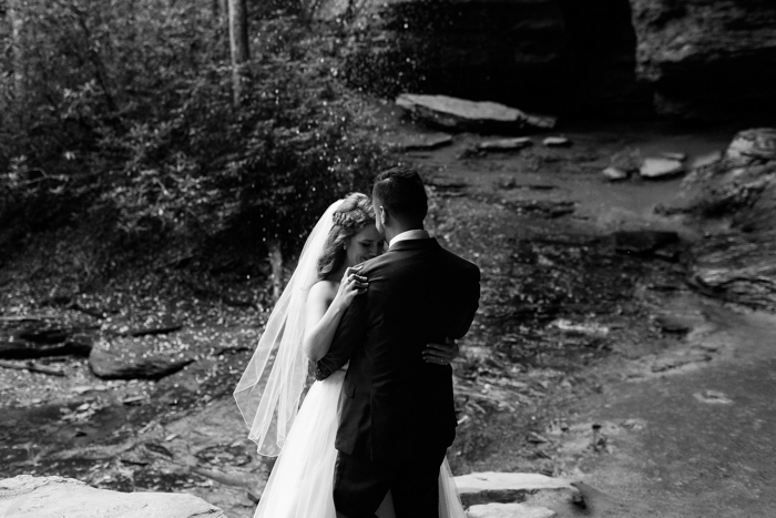 bride and groom dancing in black and white photo